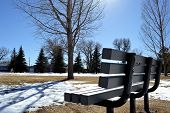 stock photo of undine  - An empty seat in Undine Park in a cold winter - JPG