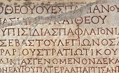 stock photo of building relief  - Old greek scriptures in Ephesus Turkey  - JPG
