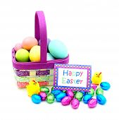foto of easter candy  - Easter basket close up with colorful eggs - JPG