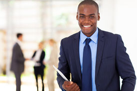 pic of half-dressed  - handsome african american businessman with tablet computer in office - JPG