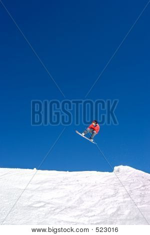 Huge Snowboarding Jump On Slopes Of Ski Resort In Spain