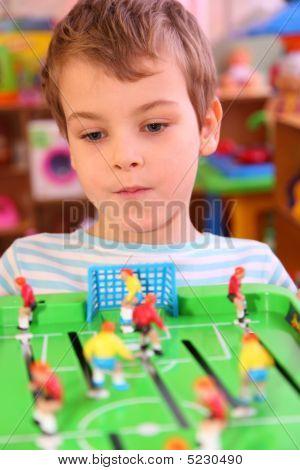 Boy Plays In Toy Football