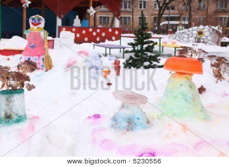 Children's Playground In Court Yard In Winter