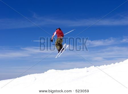 Man Skiing On Slopes Of Pradollano Ski Resort In Spain