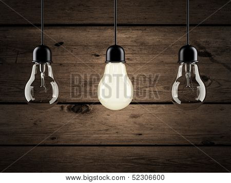 unique bulb on wooden background