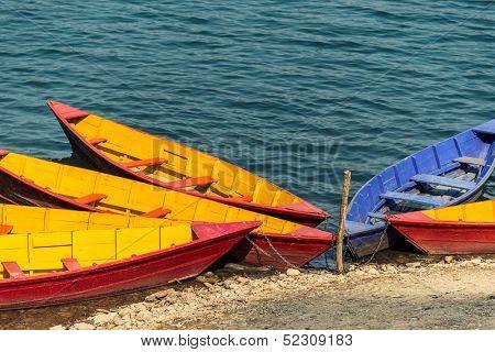 Colorful barques on Phewa Lake in Pokara, Nepal