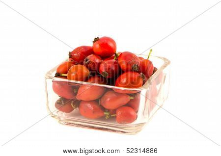 Wild Dog Rose Fruits In Glass Plate Isolated On White