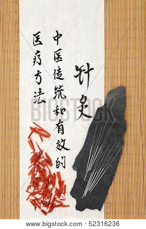 Acupuncture needles with sandalwood and mandarin script on rice paper over bamboo.Tan Ziang. Translation describes acupuncture chinese medicine as a traditional and effective medical solution.