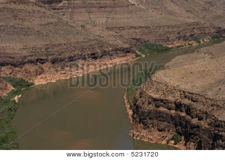 Colorado River And Mountains In Grand Canyon