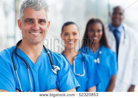handsome senior medical doctor and team at hospital