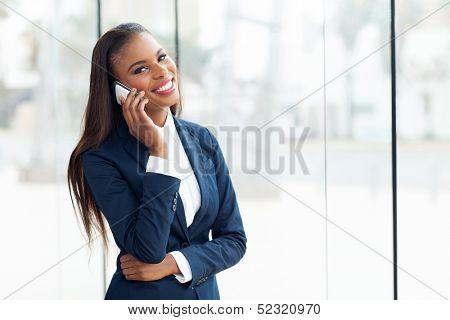 beautiful african american business executive making a phone call