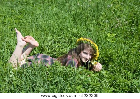 Girl In A Chaplet Lying From Meadow