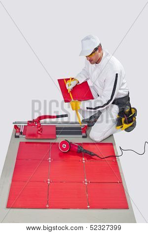 Worker cutting ceramic tile