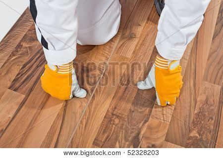 Worker checks old wooden floor