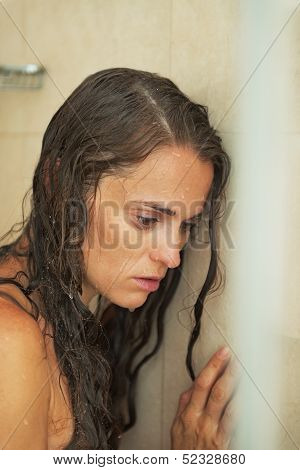 Portrait Of Frustrated Young Woman In Shower