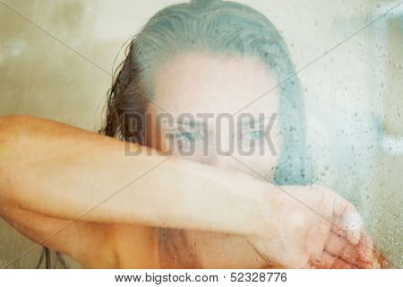 Stressed Woman Leaning On Weeping Glass Shower Door