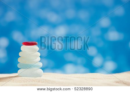 sea glass seaglass with flittering sea, beach and seascape, shallow dof