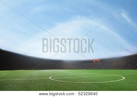 Digital composit of soccer field and blue sky