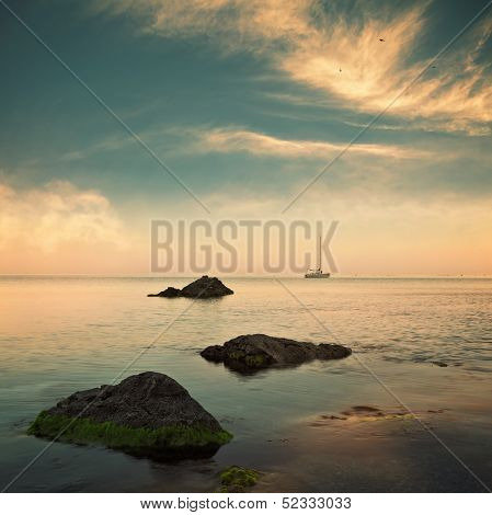 Sea And Sailboat On Horizon With Cloudy Sky