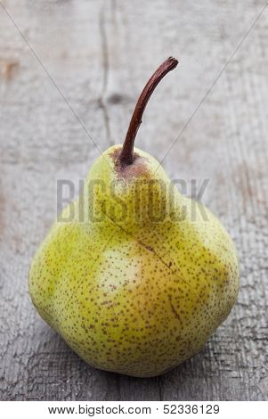 Yellow Duchesse Pear On Wood