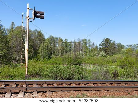 Railway Fragment With Semaphore And Forest On A Background