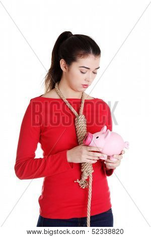 Economic crisis concept. Young woman holding piggy bank going to commit suicide.
