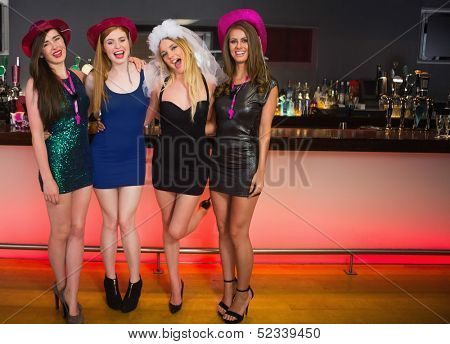 Portrait of laughing friends having a hen party looking at camera