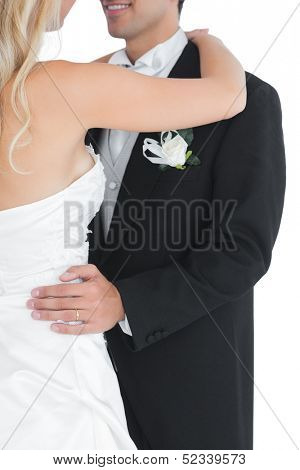 Close up of a married couple dancing viennese waltz on white background