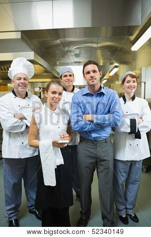 Restaurant team posing together in a kitchen