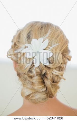 Rear view of blonde bride with a chick coiffure