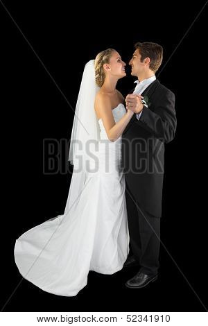 Lovely young young married couple dancing viennese waltz on black background