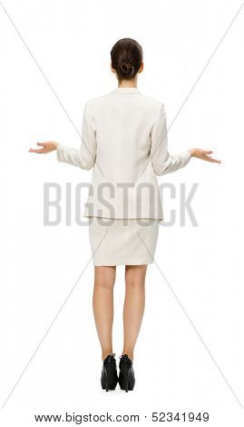 Full-length backview of businesswoman with outstretched arms, isolated on white. Concept of leadership and success