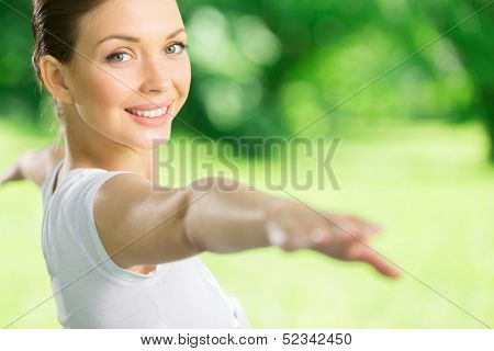Portrait of girl with outstretched arms exercising. Concept of healthy lifestyle and relaxation