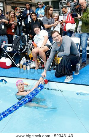 NEW YORK- OCT 8: Swimmer Diana Nyad and Olympic gold medalist Ryan Lochte attend Day 1 of 'Swim For Relief' benefiting Hurricane Sandy Recovery at Herald Square on October 8, 2013 in New York City.