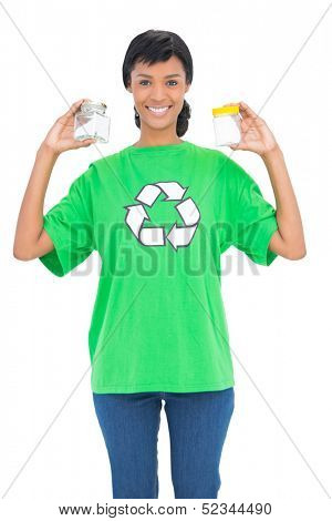 Content black haired ecologist holding jars on white background