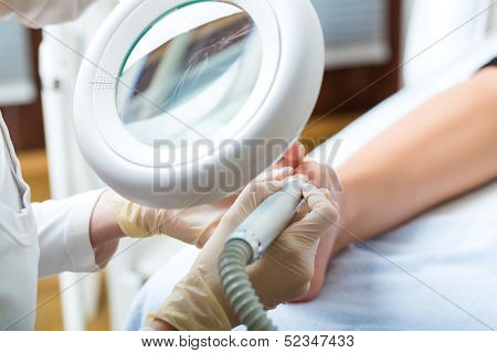 Woman receiving podiatry treatment in Day Spa