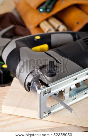 electric fretsaw on a wooden table