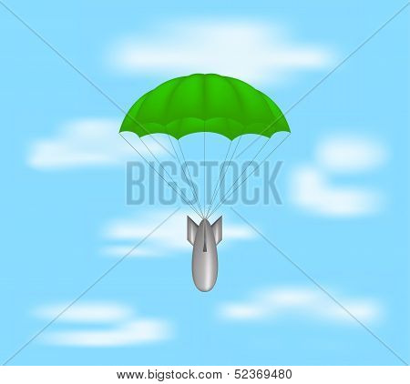 Bomb at green parachute on blue sky