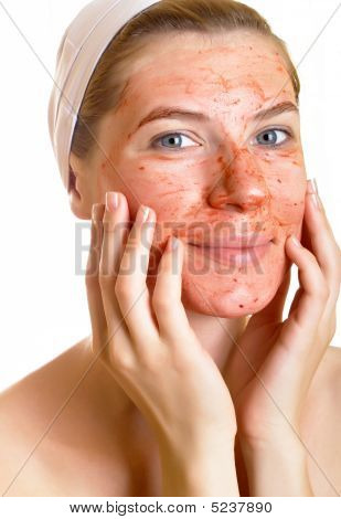 Young woman with fruit mask