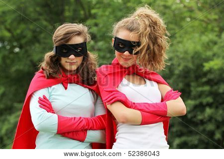 Super team of super hero girl with red cape and red gloves