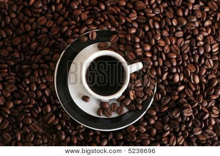 Coffee Beans And A Cup Of Black Coffee