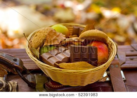 Apples, Oatmeal Cookies, Chocolate In The Basket In The Autumn P