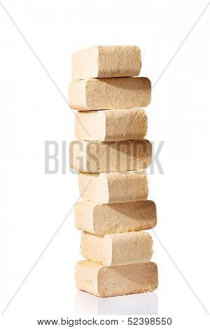 Wood sawdust briquettes , isolated on white