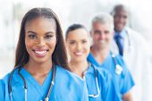 picture of multicultural  - group of happy healthcare workers line up - JPG