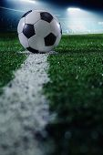 foto of flood-lights  - Soccer field with soccer ball and line - JPG