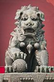 picture of lamas  - The bronze lion statue in front of Yonghe Temple also known as Palace of Peace and Harmony Lama Temple or simply Lama Temple in Beijing China - JPG