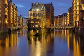 picture of illuminating  - The beautiful Speicherstadt in Hamburg illuminated at night - JPG