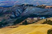 stock photo of senesi  - Farm on the clay hills of Crete Senesi in Tuscany Italy - JPG