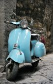 stock photo of vespa  - Classic Vespa scooter parked in an Italian street - JPG