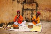 JAIPUR, INDIA: SEPT 24:Old snake charmer man with his apprentice in Jaipur, despite a sort of golden